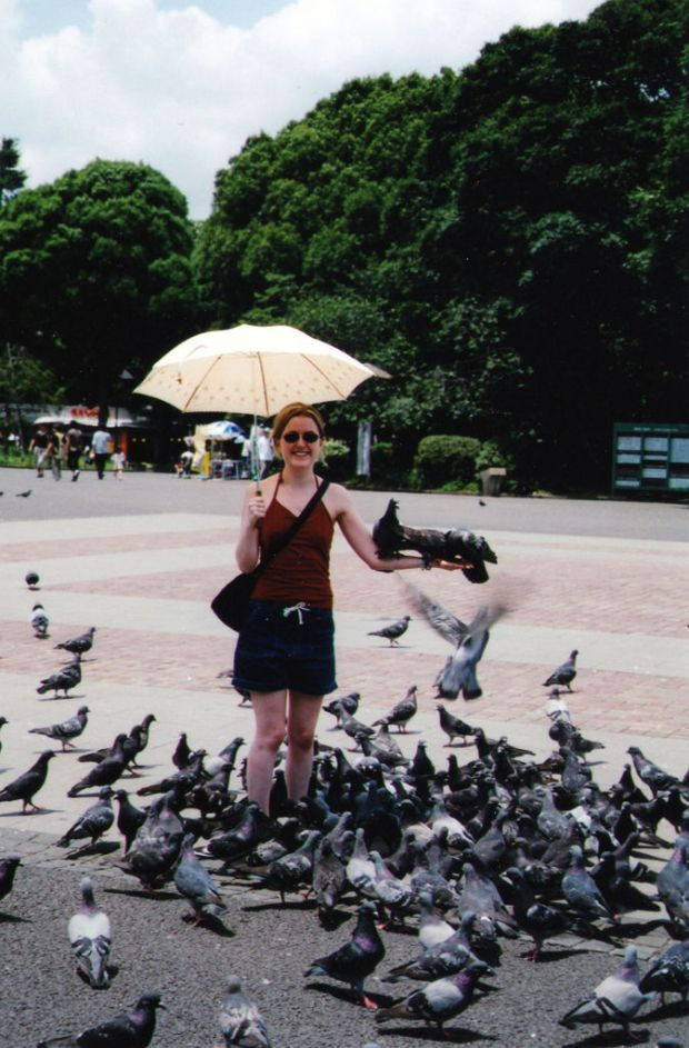 My sister feeding pigeons in Ueno Park